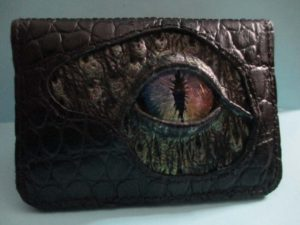 Leather wallet/business card holder with a hand painted glass eye. ©Suzan Houston Bessie Hyde Leather Works