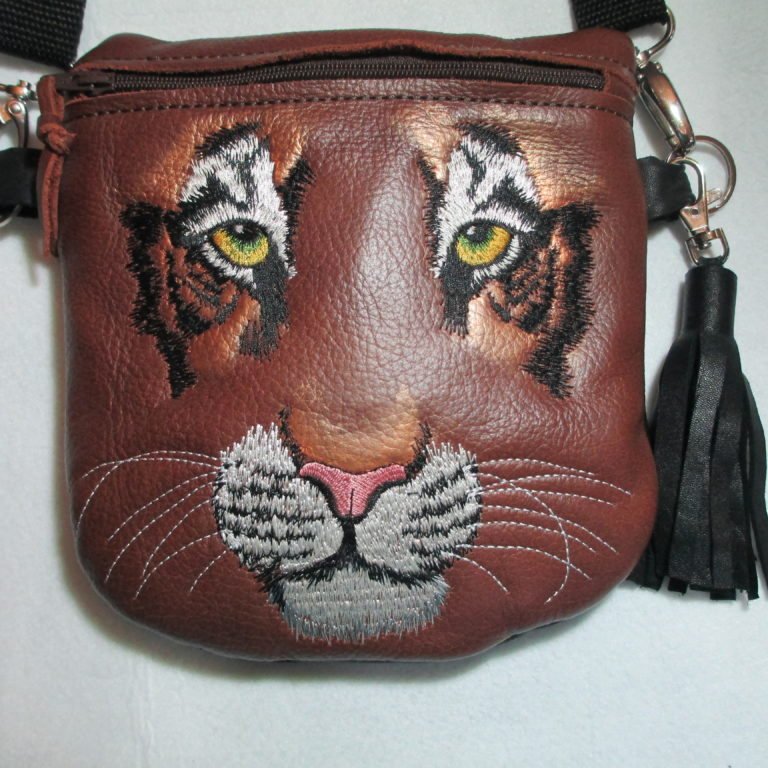 Leather tiger purse with tassel, embroidered and painted. ©Suzan Houston Bessie Hyde Leather Works