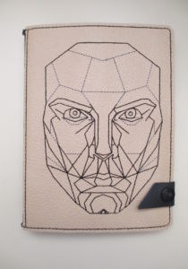Leather journal cover with the golden ration proportional male face image-embroidered.  ©Suzan Houston  Bessie Hyde Leather Works